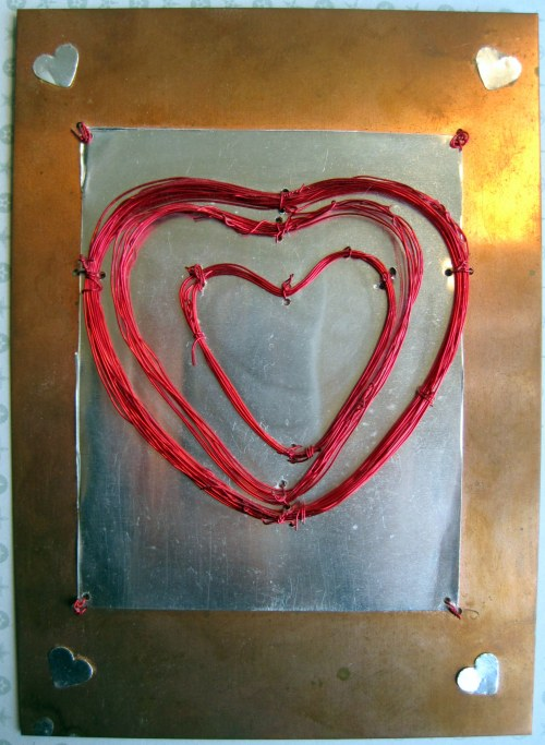 Red wire heart on copper