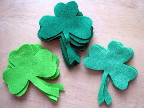 3 green piles of shamrocks