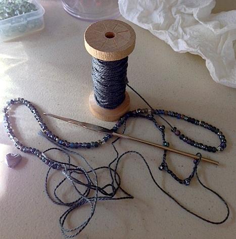 Beads Threaded on Yarn