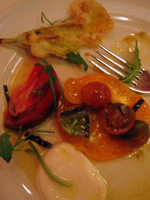 Half-eaten tomato appetizer