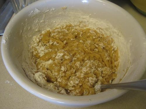 Gradually add the flour into the dough.